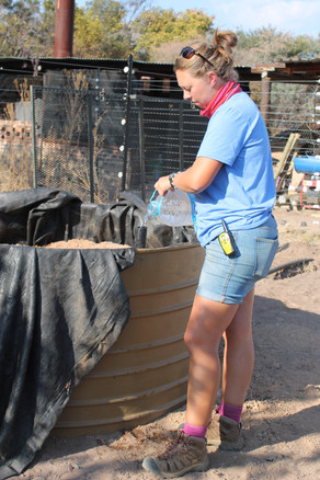 Johannah helping in the reserve's recycling area.