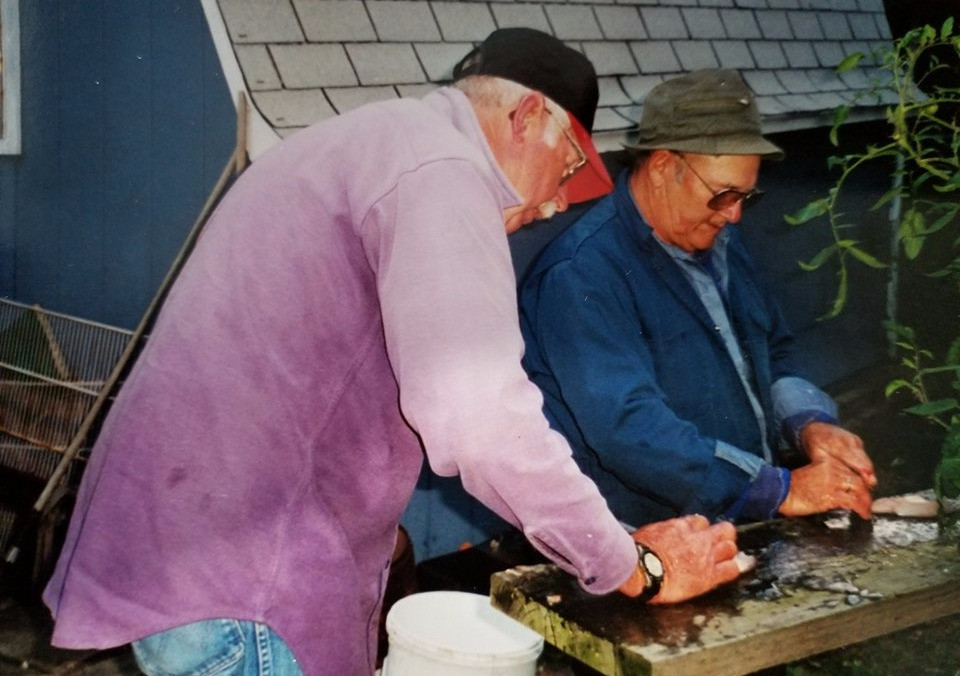 Bill Stork, Sr. and LeRoy Summers, cleanin' fish