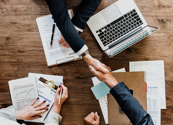 business-people-shaking-hands-together_e