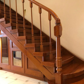 Magnificent staircase made of expensive wood