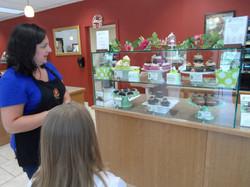 Lynne Explaining the cupcakes