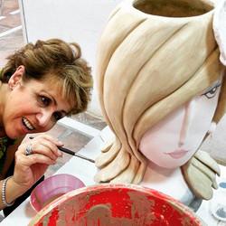 Mehry glazing her vase