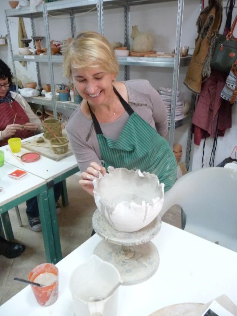Patricia T glazing her coil pot
