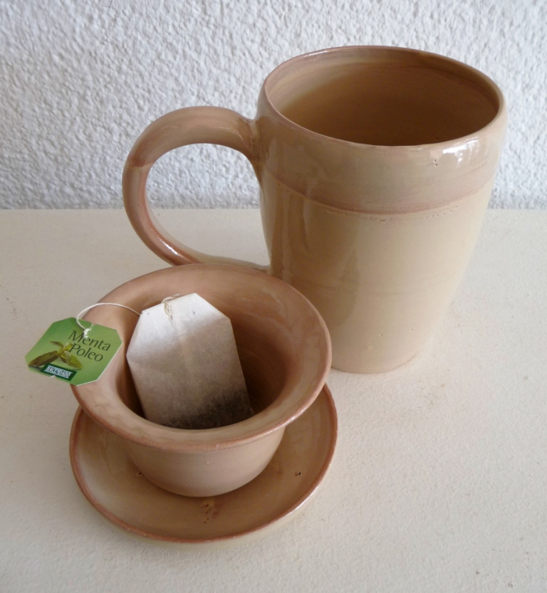 Tea Cup and strainer by Vera