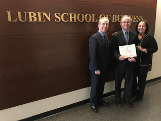 Pace SBDC Director Andrew Flamm with Neil Braun, Dean of Pace University's Lubin School of Business, and Beth Goldberg District Director of SBA's New York District