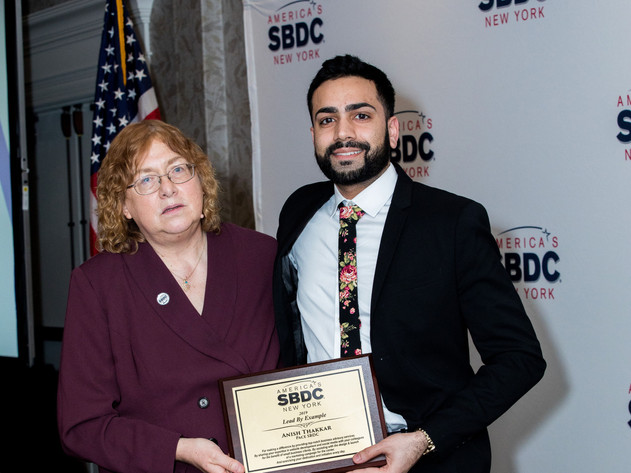Pace SBDC Business Advisor Anish Thakkar receiving the lead by Example award from NYSBDC's Associate State Director, Mary Hoffman