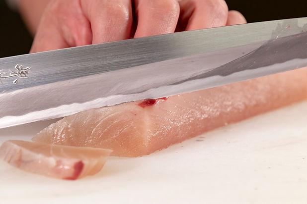 sashimi being sliced.jpg