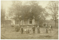 Gray family with house.jpg