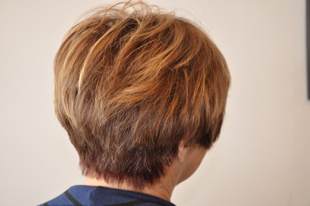 Cropped, colored, and highlighted hair by Tiffany