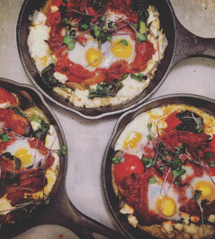 Shakshuka with tomatoes spinach & quail eggs