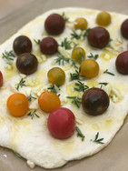 Focaccia with chetty tomatoes and garlic