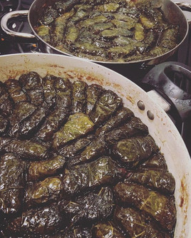 Rice stuffed grape leaves in pomegranate molasses