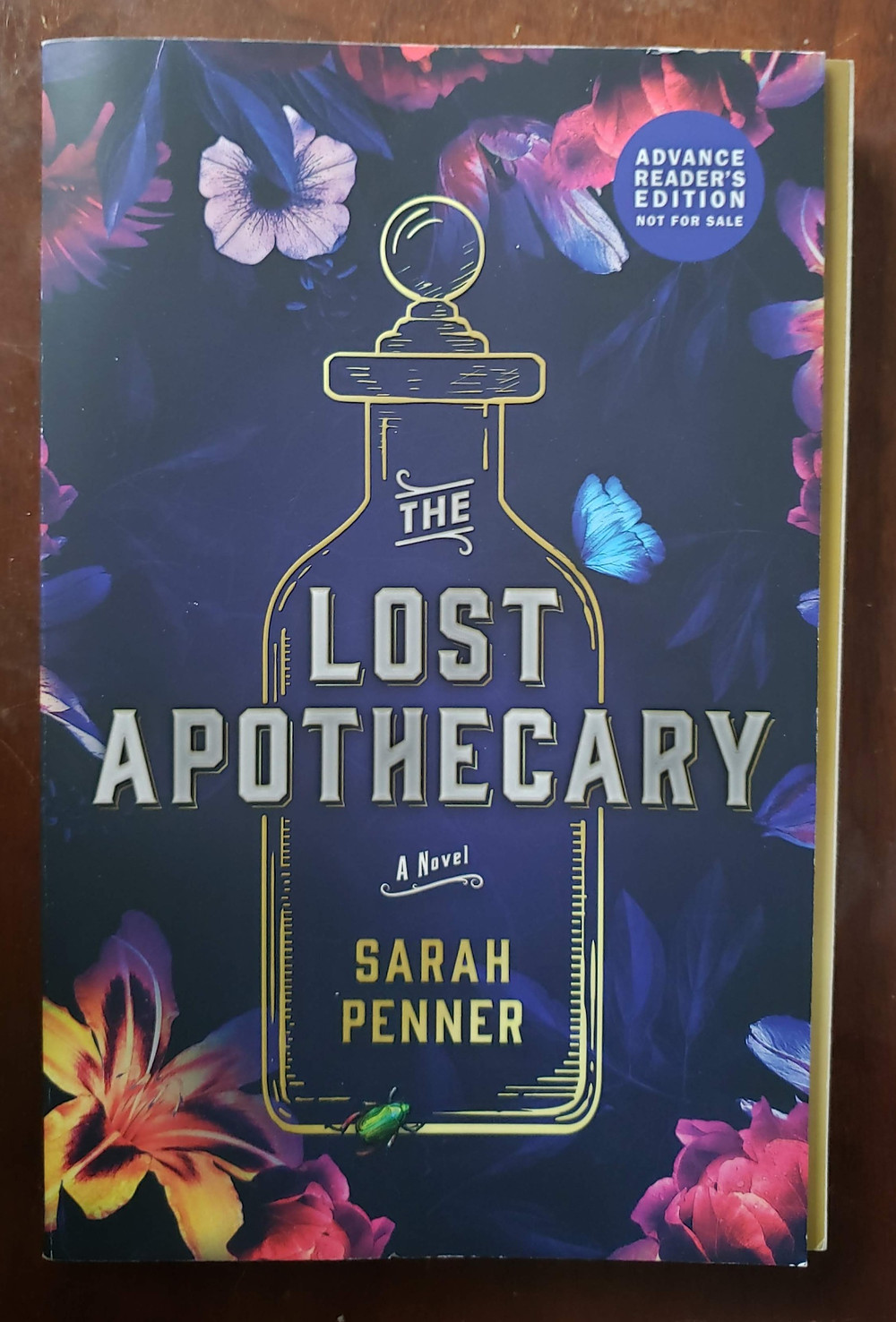 The front facing cover of the book The Lost Apothecary by Sarah Penner.