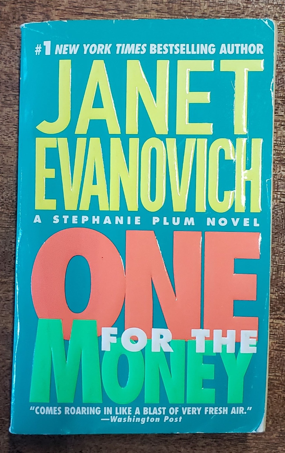 The front facing cover of the book One for the Money by Janet Evanovich.