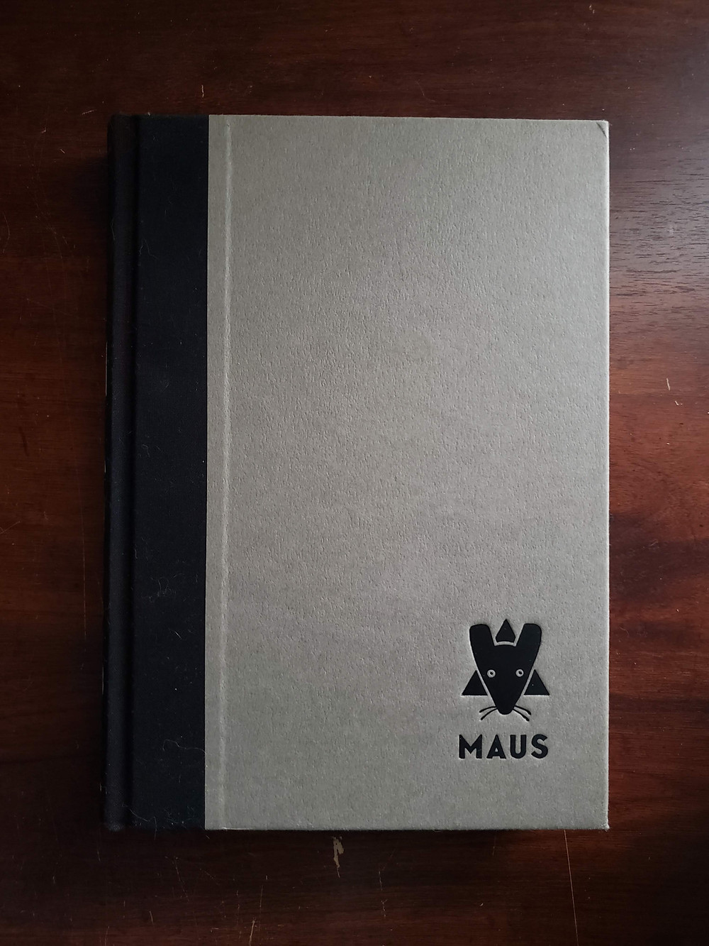 Front image of the cover for The Complete Maus by Art Spiegelman.