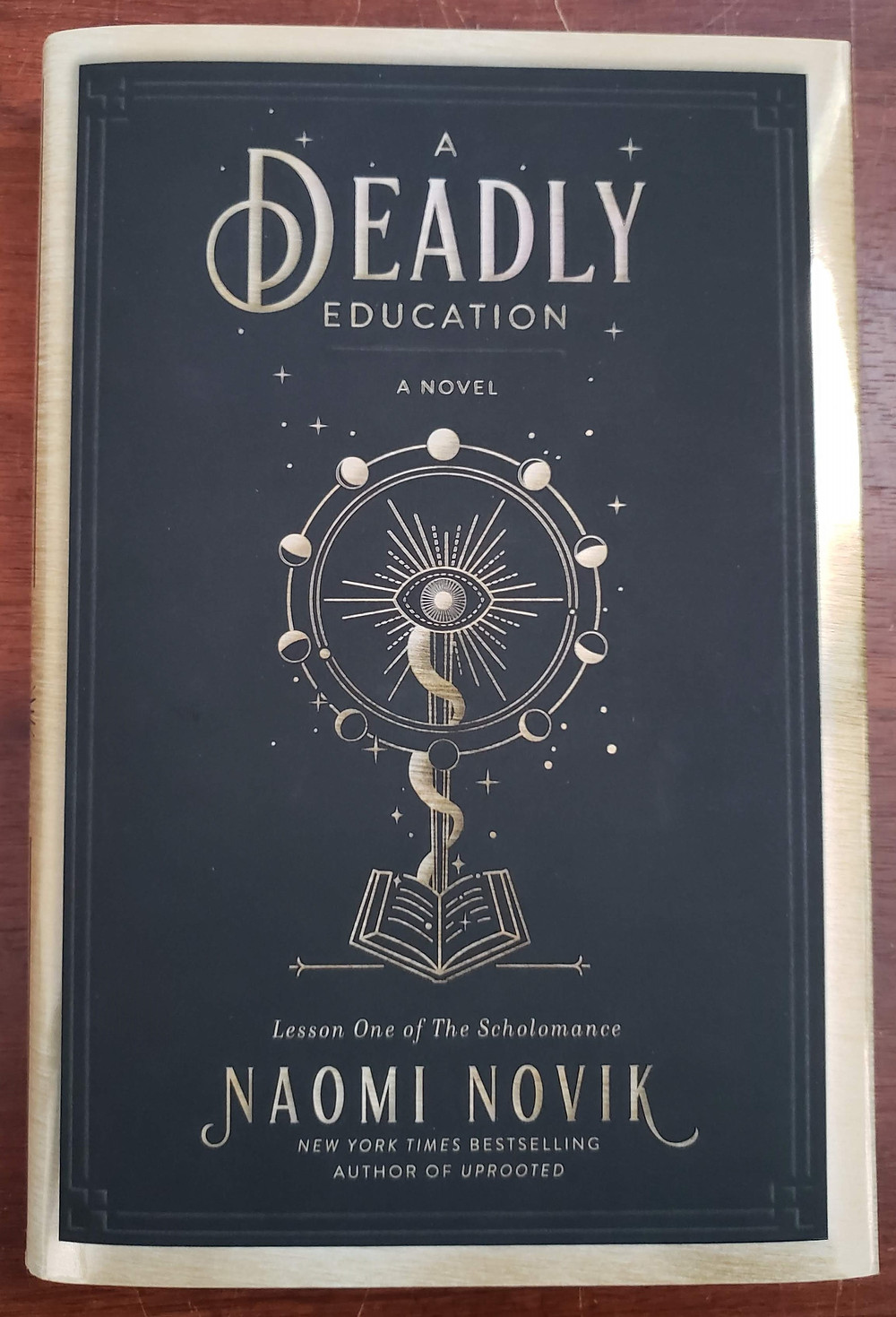 Front image of the book cover of A Deadly Education by Naomi Novik.