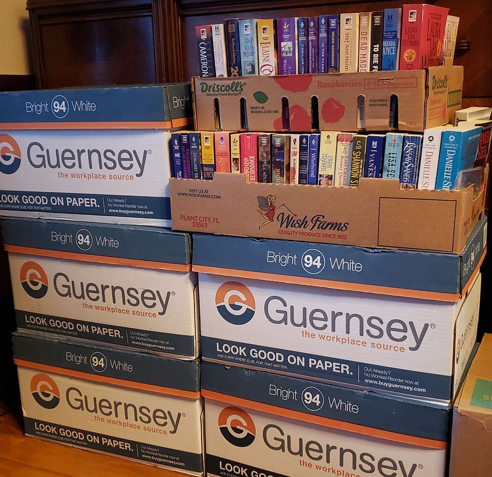 Two stacks of boxes containing a variety of books.