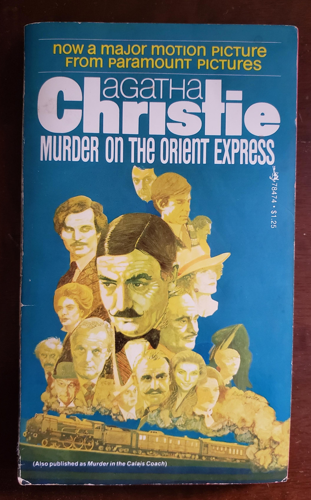 The front facing cover of the book Murder on the Orient Express by Agatha Christie.