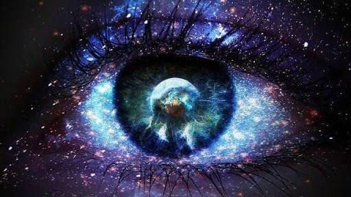 Galaxies reflected in an open eye
