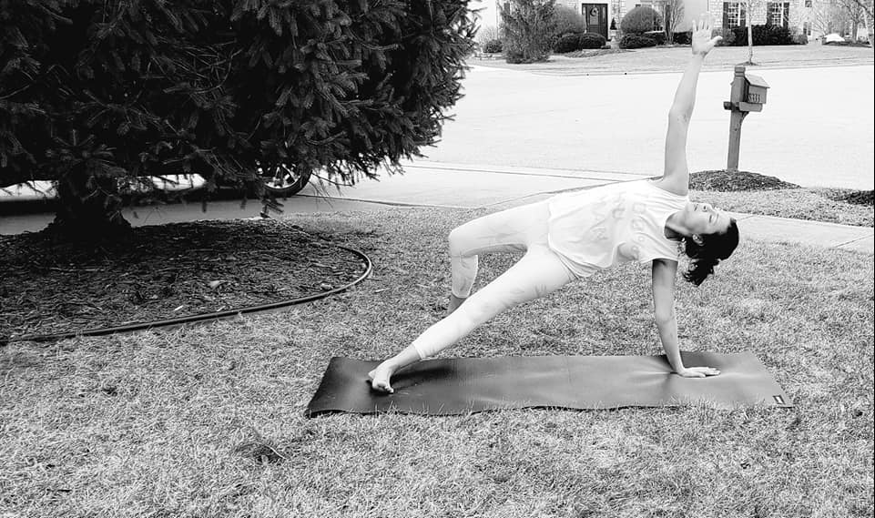 Yoga instructor doing a pose to aid recovery after car crash