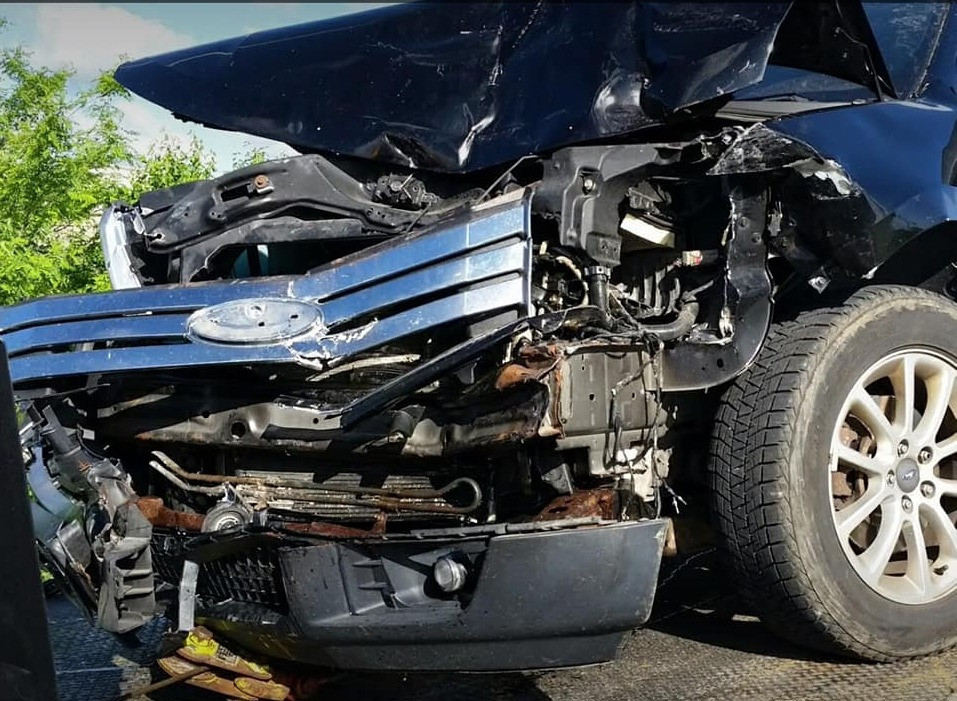 Destroyed car after accident that injured yoga instructor that runs this website.
