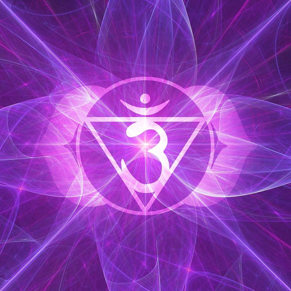 Purple fractals surrounding an Om symbol