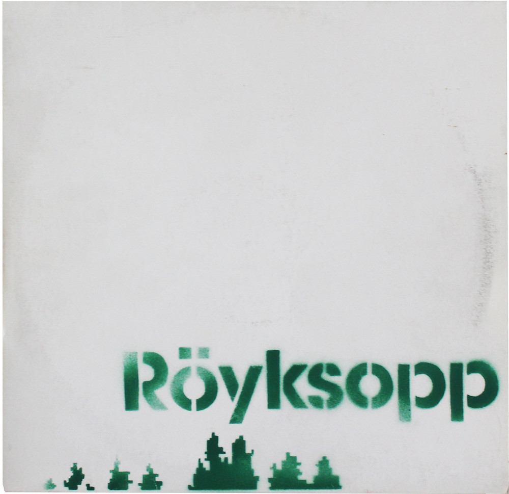 """Banksy was associated with the Wall of Sound label and its subsidiaries. He designed several covers including a second hand sprayed promo for Röyksopp's """"Melody A.M."""" album."""