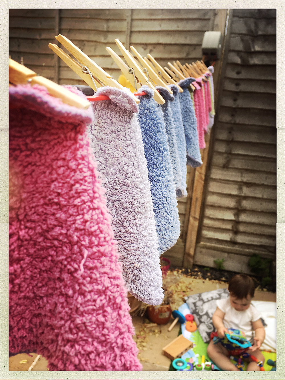 Cheeky wipes drying on the line and child entertaining herself #mothergoals