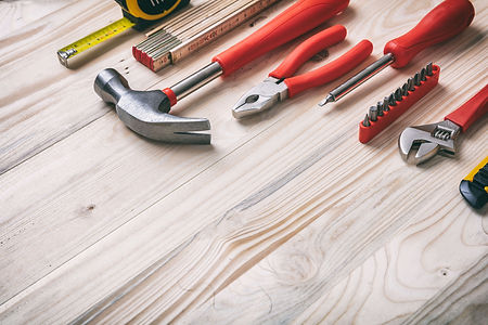 hand-tools-set-on-wooden-table-copy-spac