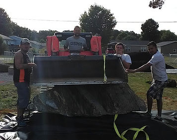 keyser lawn and landscaping uses big machines to move heavy rock for hardscaping