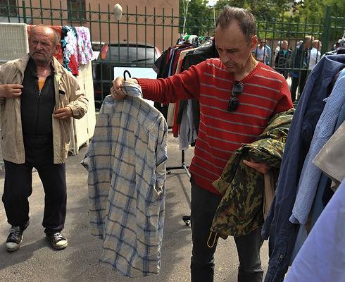 bigstock-The-Distribution-Of-Free-Cloth-162654818 lowres.jpg