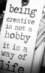 """Decorative tag with inspiratonal saying """"beng creative is nota hobby, it is a way of life""""."""
