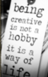 "Decorative tag with inspiratonal saying ""beng creative is nota hobby, it is a way of life""."