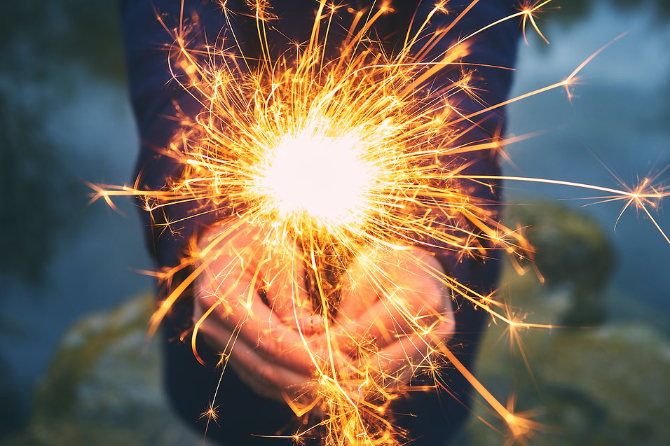 woman-holding-sparkler-in-forest-winter-