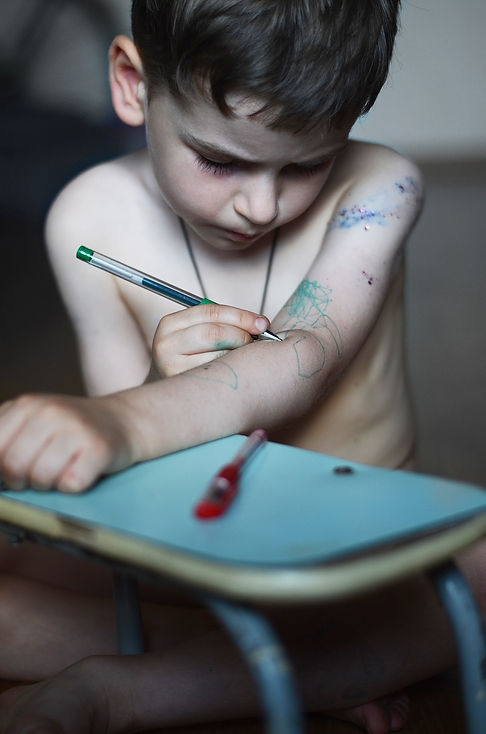 a-little-boy-draws-himself-a-tattoo-with