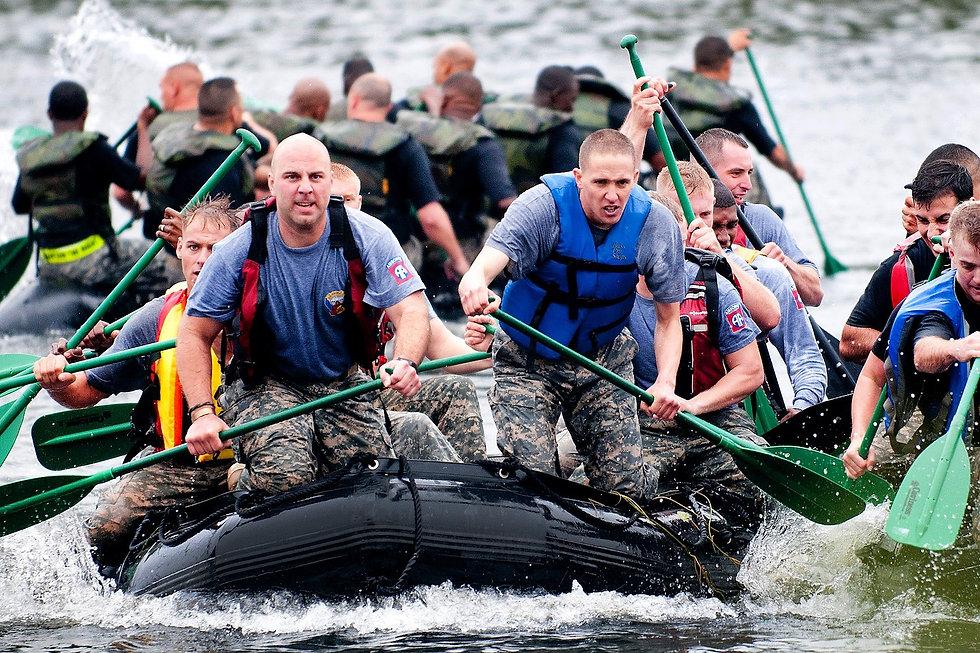 men-paddling-in-inflatable-raft-boat-dur
