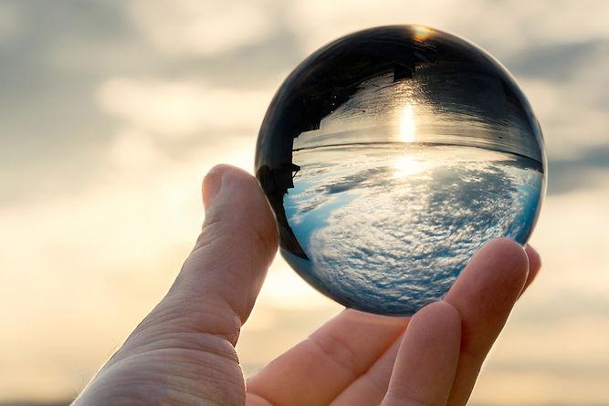 sky-in-crystal-ball-in-hand-N4ZX8DN.jpg
