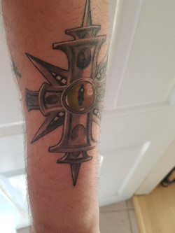 John Matthews TI tattoo