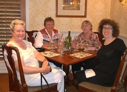 Julie Lindberg, Linda Lefko, Jane Radcliffe, and Jennifer Mass meeting over a meal in Deerfield