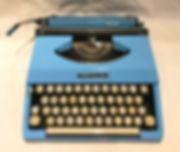 Royal Mariner - photograph of a small, powder blue typewriter with white keys mounted on silver key levers.
