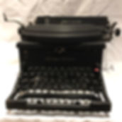 Remington Noiseless 10 - photograph of a large matte-black typewriter with black keys mounted on black key levers.