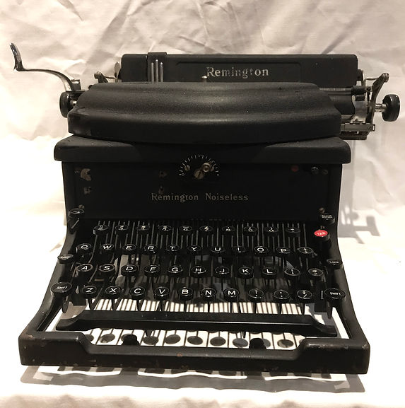 Remington Noiseless 10 - photograph of a large matte-black typewriter with black keys mounted on black key levers.