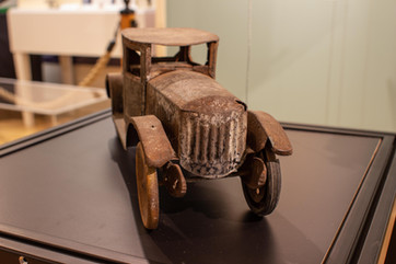 TCHM Exhibit 4.jpg - front view of a metal toy car (object 63.35.118). The front of the engine block has vertical ridges to mimic a car's grill.