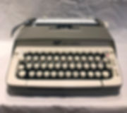 Smith Corona Galaxie - photograph of a medium gray typewriter with ivory keys in a modern keyboard configuration.
