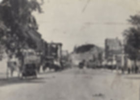 Photograph c. 1915 of Washington Avenue in Grand Haven, MI, looking toward Dewey Hill. 73.42.3