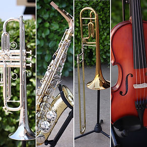 Picture of a trumpet, saxophone, trombone and violin
