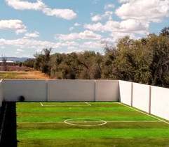 Cancha de Pasto  Sintético futbol 5 franjeada en Apple Green y Lima