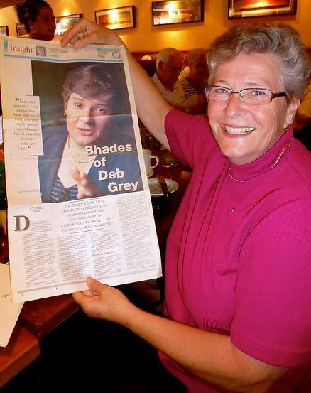 Deb holding u p newspaper_straight-shoot