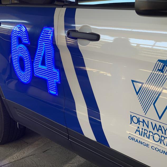 John Wayne Airport using lighted car numbers