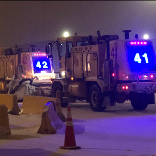 Lighted truck numbers Denver Airport Snow Plows